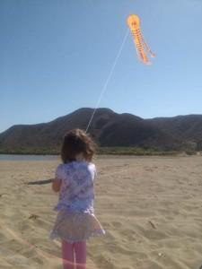 Maya flying her kite at La Bocana beach