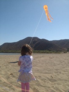 Maya flying her kite at La Bocana beach