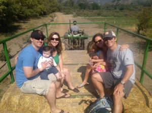 On a hayride at Avila Farm with cousins Jacquie, Devin and baby Gavin.