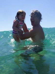 Maya jumping the waves with Brian